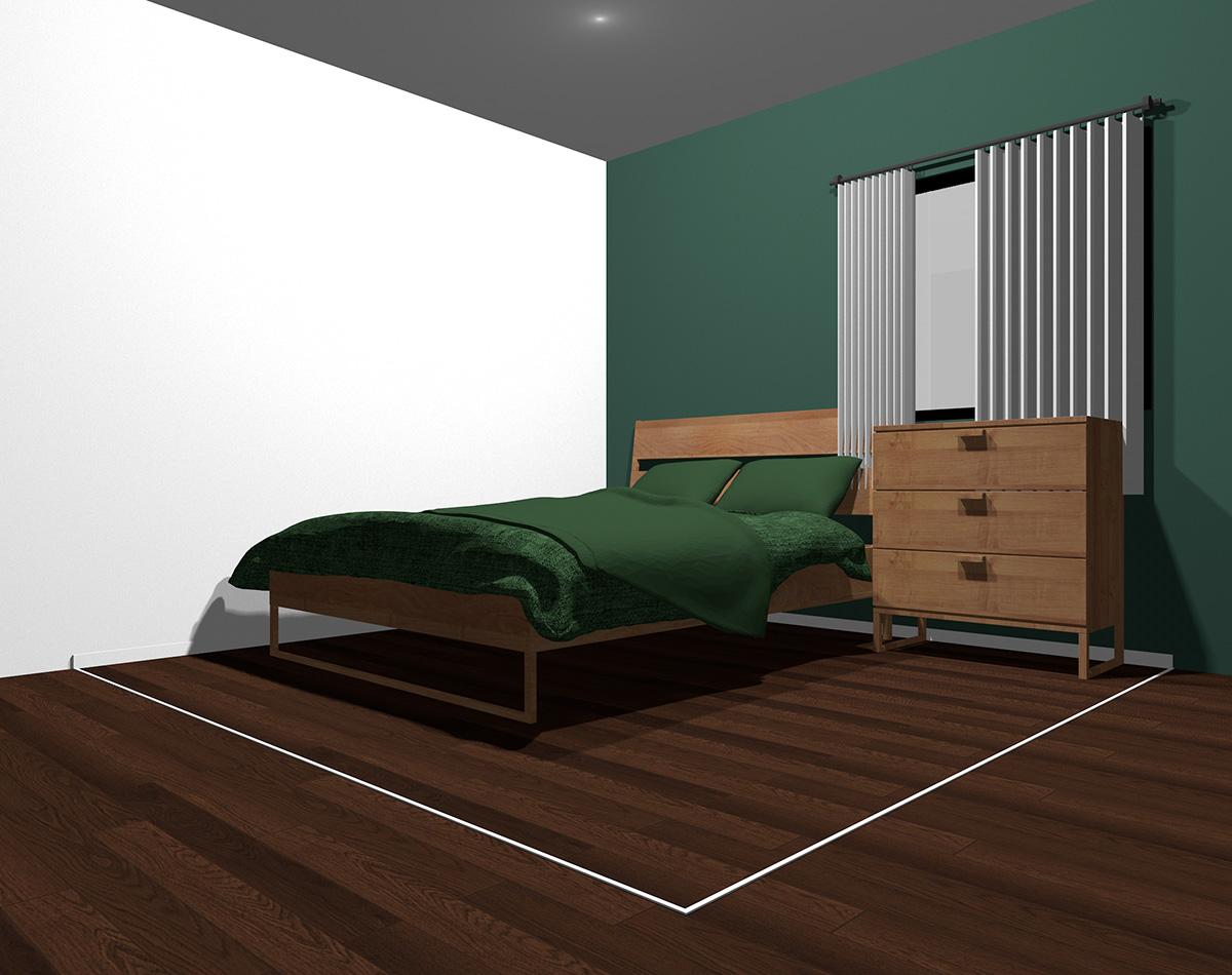 暗いグリーンでまとめた4畳半の狭い寝室