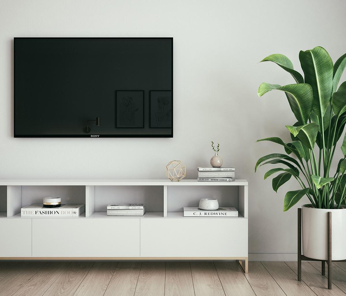 壁掛けテレビとホワイトのシンプルなテレビボードの組み合わせ
